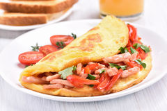 Egg omelette with vegetables and ham Stock Photos