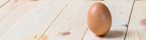 Egg. One egg on wooden background Stock Photo