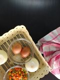 Egg, onion and vegetables in basket with cloth royalty free stock photos