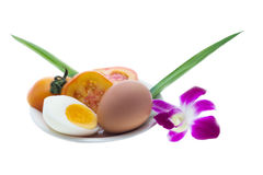 Egg and orchid. In white background Stock Photos
