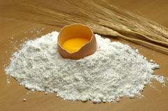 Egg Over Flour Stock Photography
