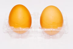 Egg with package Stock Photos