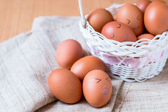 Egg. Painted emotion with happy face on eggs in basket on sack Royalty Free Stock Images