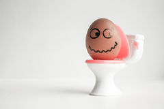 An egg with a painted face. Cute egg. Photo Royalty Free Stock Photos