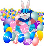 Egg Painter. Funky Easter bunny, is painting the eggs for the kids egg hunt Royalty Free Stock Images