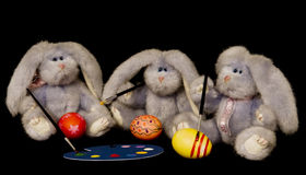 Egg-Painting Bunnies Royalty Free Stock Images