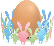 Egg and Paper Rabbit. Egg surrounded by papper rabbit Stock Images