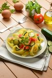 Egg pappardelle with zucchini and tomato. Closeup Royalty Free Stock Images