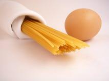 Egg pasta. Pasta and egg on the white backsgraund Stock Photos