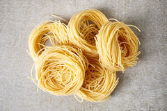 Egg pasta nest on stone table, from above Royalty Free Stock Photography