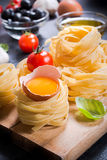 Egg in pasta Royalty Free Stock Image