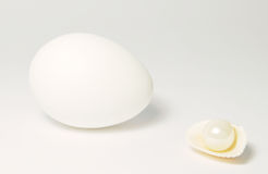 Egg and pearls Stock Images