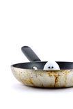 Egg Peeking Out of Frying Pan stock images