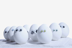 Egg people. Eggs with eye balls lined up in rows, with space for own nose and mouth addition Royalty Free Stock Photography