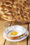 Egg and pide. Fried egg in a shallow cooking pan and traditional Turkish breads : Pide Royalty Free Stock Photography