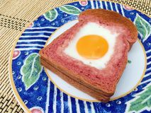 Egg in the pink bread Royalty Free Stock Photography