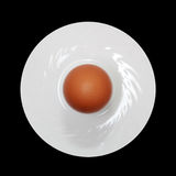 Egg on a plate. At the black background Stock Photo