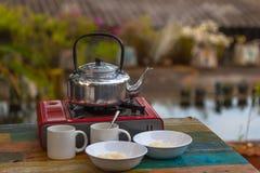 Egg porridge and hot coffee for breakfast. Easy fast food cooking a simple egg porridge and hot coffee for breakfast Royalty Free Stock Photo
