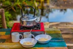 Egg porridge and hot coffee for breakfast. Easy fast food cooking a simple egg porridge and hot coffee for breakfast Stock Image