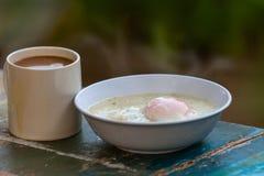 Egg porridge and hot coffee for breakfast. Easy fast food cooking a simple egg porridge and hot coffee for breakfast Stock Photo