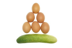 Egg put as triangle and cucumber isolated Stock Images