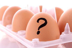 Egg with question mark  in box isolated Stock Photography