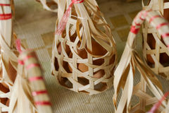 Egg in rattan bag Stock Photography