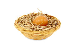 Egg in rattan basket isolated on white Royalty Free Stock Image