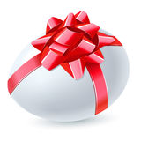 Egg with red bow Royalty Free Stock Images
