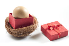 Egg in red gift box on white background. Easter concept Royalty Free Stock Photography