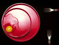 Egg on Red Plate Stock Images