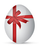 Egg with a red ribbon Royalty Free Stock Photos