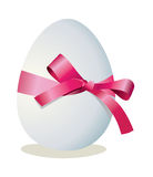 Egg and ribbon with a bow Stock Photography