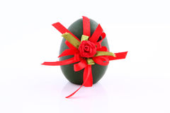 Egg with a ribbon Stock Photos