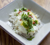 Egg on rice with cilantro and hot sauce. Delicious royalty free stock photography