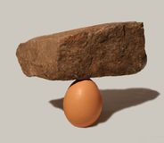 Egg rock. A rock balanced on a egg Royalty Free Stock Photography