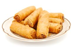 Egg rolls. The special egg rolls plate isolated white royalty free stock image