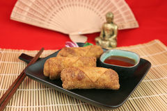 Egg Rolls & Buddha royalty free stock photos