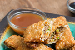Egg Rolls with sauce. Crunchy egg rolls stuffed with cabbage, carrots and pork with a side of sauce Royalty Free Stock Photos