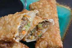 Egg rolls with soy sauce. Crunchy egg rolls with soy sauce on the side Royalty Free Stock Photography