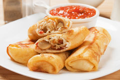 Egg rolls with tomato sauce Stock Photos