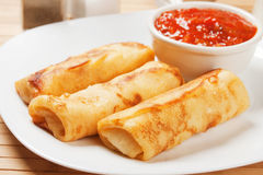 Egg rolls with tomato sauce Royalty Free Stock Image