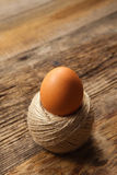 Egg in rope coil Royalty Free Stock Photography