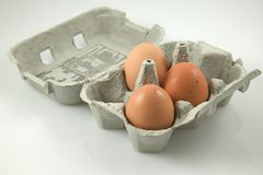 Egg's in a box. Three brown egg's in an egg box Stock Images
