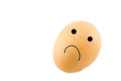 Egg with sad face Royalty Free Stock Photos