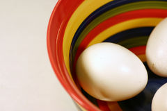 Egg Salad. Colorful striped bowl with three eggs inside royalty free stock photography