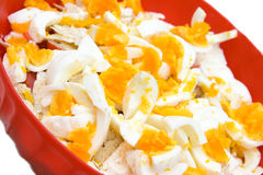 Egg salad. In a red tureen Royalty Free Stock Photography