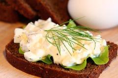 Egg salad. On black bread royalty free stock photo