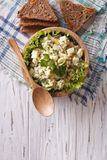 Egg salad and bread vertical top view, rustic style Stock Photo