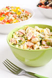 Egg salad in a green bowl with fork Stock Photos